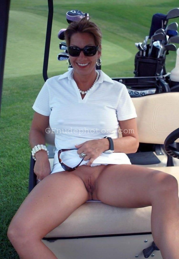 Horny milf lifting her skirt on golf course to show her old wet pussy